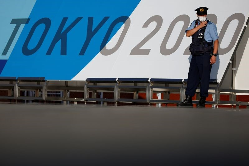 Olympic Tokyo: Ca mac COVID-19 dau tien tai lang van dong vien hinh anh 1