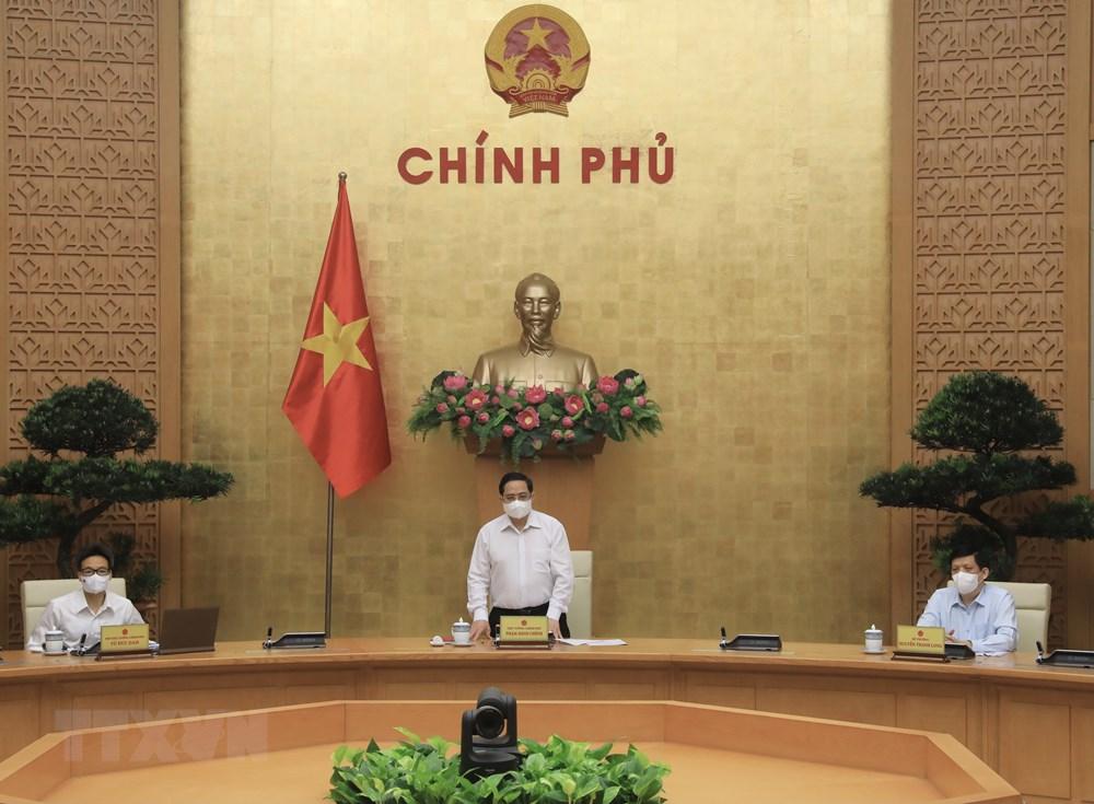 [Photo] Thu tuong chi dao cong tac truoc dien bien moi cua dich benh hinh anh 1