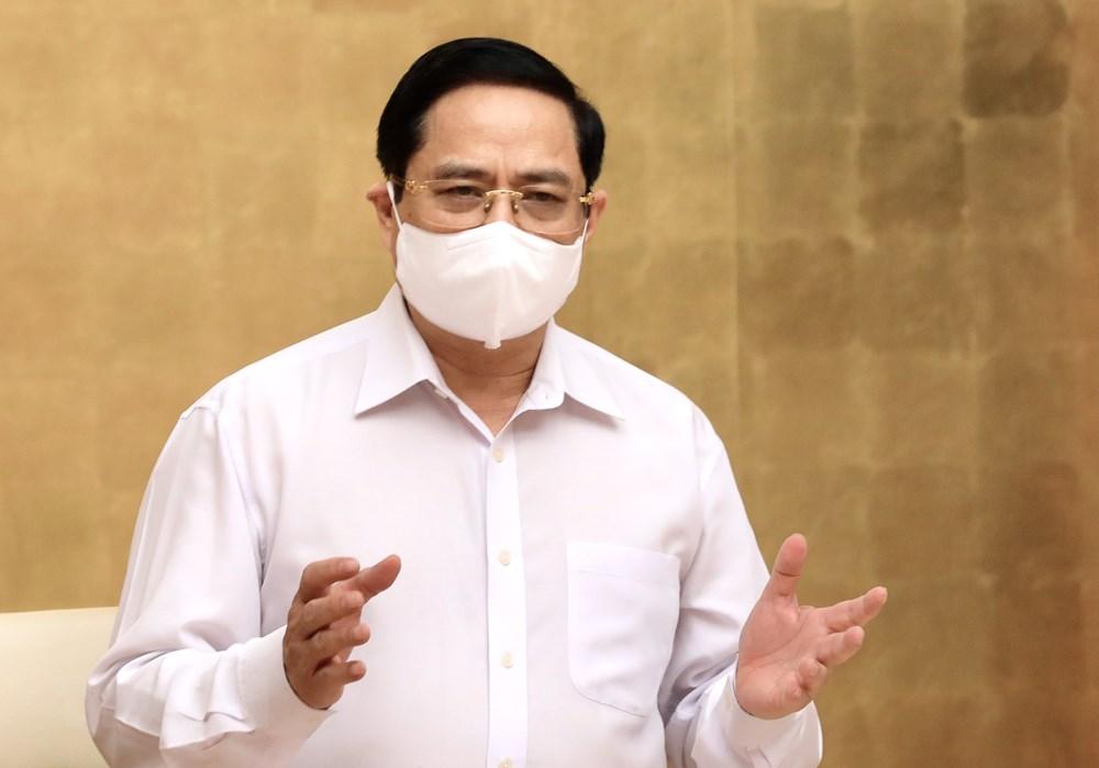 [Photo] Thu tuong chi dao cong tac truoc dien bien moi cua dich benh hinh anh 6