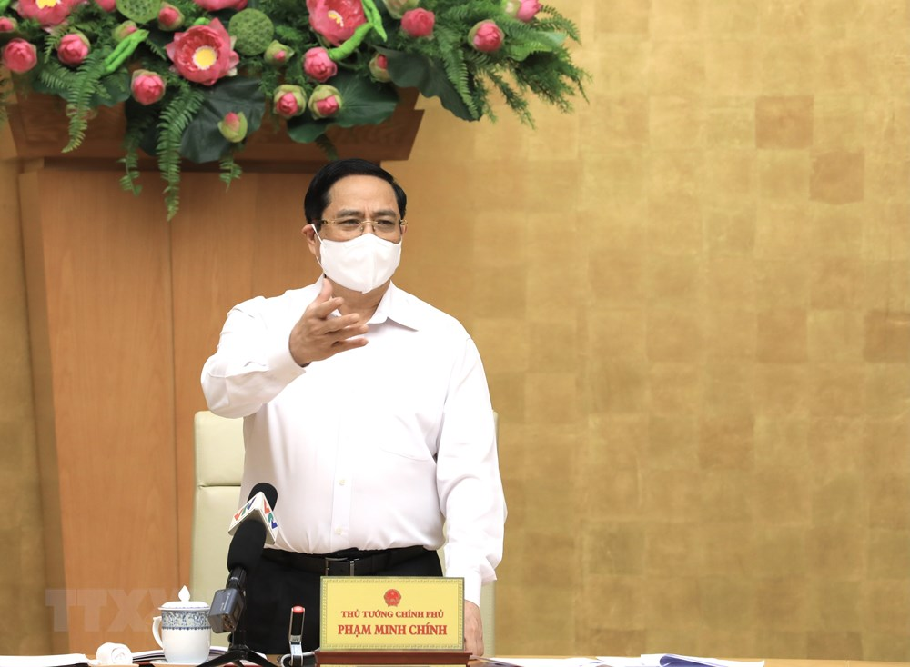 [Photo] Thu tuong chi dao cong tac truoc dien bien moi cua dich benh hinh anh 8