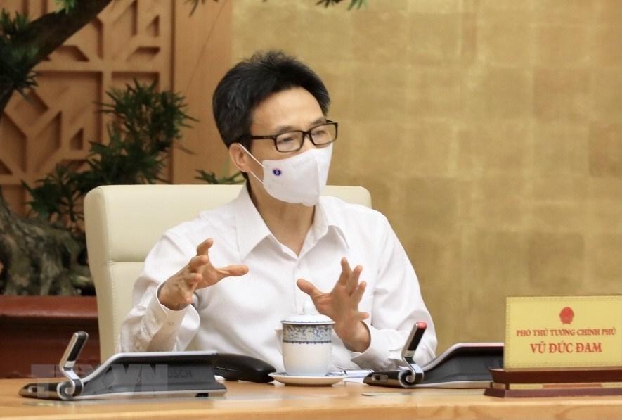[Photo] Thu tuong chi dao cong tac truoc dien bien moi cua dich benh hinh anh 12