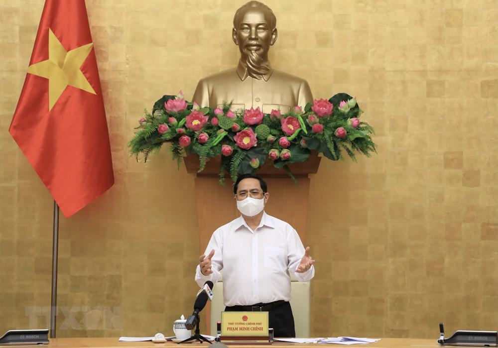 [Photo] Thu tuong chi dao cong tac truoc dien bien moi cua dich benh hinh anh 3