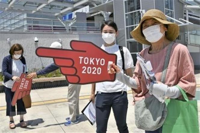 Olympic Tokyo: Nhat Ban siet chat kiem soat phong ngua bien the Delta hinh anh 1