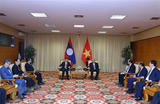 Việt Nam luôn nỗ lực hết sức mình tăng cường hợp tác với Lào - 1