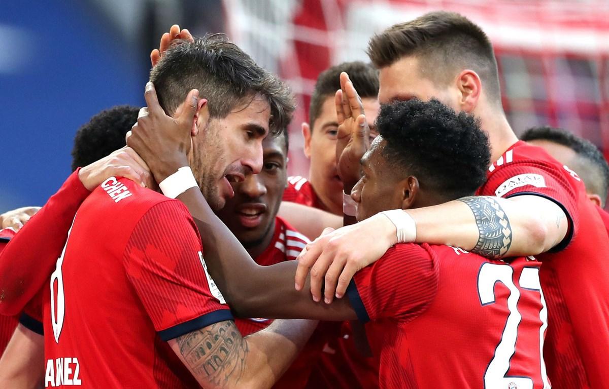 Martinez (bên trái) mang chiến thắng về cho Bayern. (Nguồn: Stadium Astro)