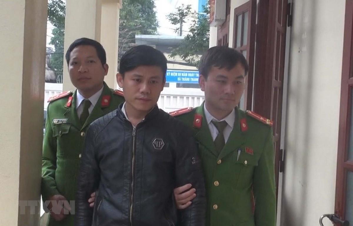 Hà Văn Khải bị lực lượng công an bắt giữ. (Ảnh: TTXVN phát)