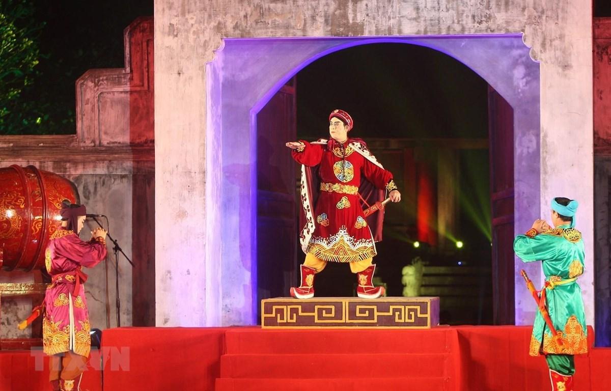 Chương trình nghệ thuật tái hiện về chiến thắng Bạch Đằng của Ngô Quyền trong lễ kỷ niệm. (Ảnh: Thanh Tùng/TTXVN)