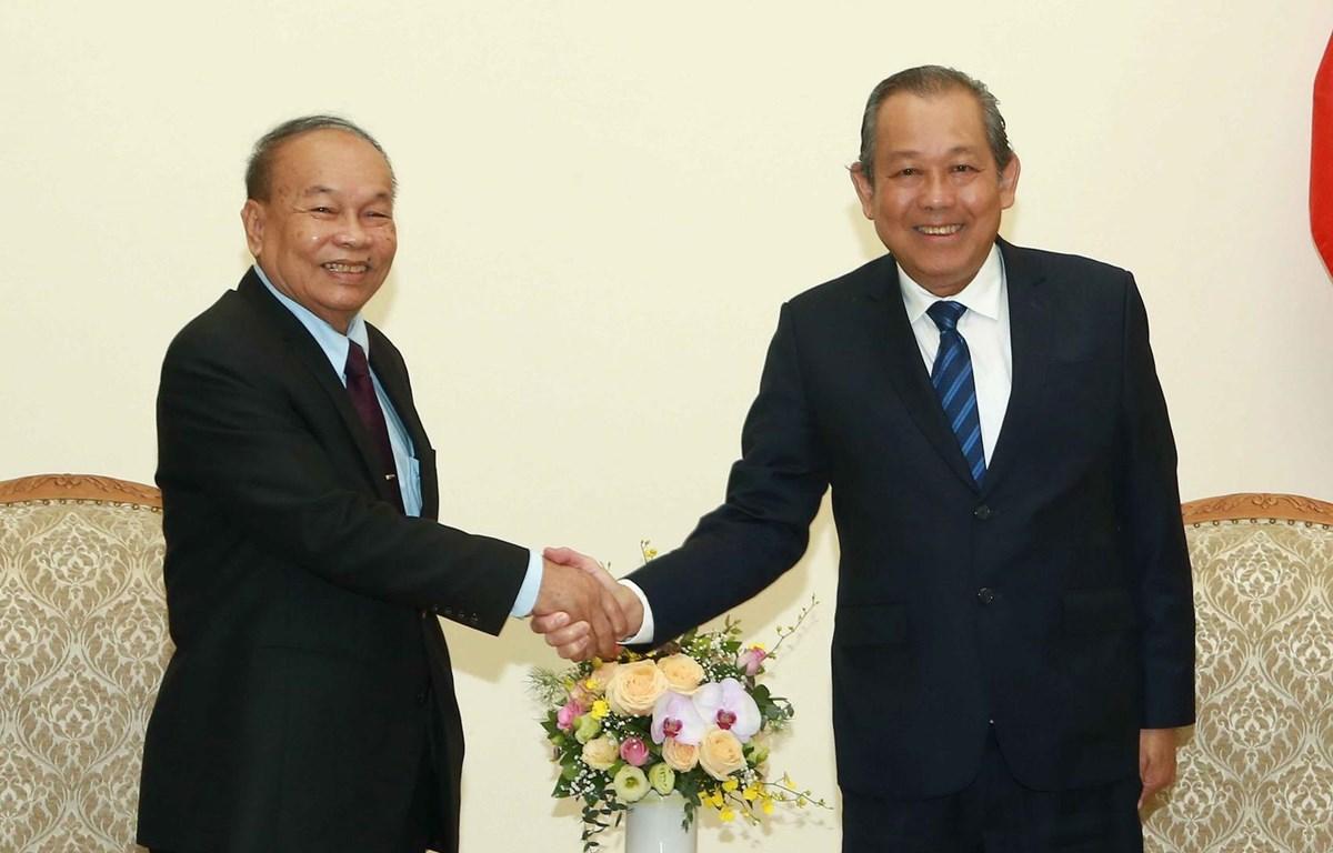 Phó Thủ tướng Thường trực Chính phủ Trương Hoà Bình đã tiếp Bộ trưởng Bộ Lễ nghi và Tôn giáo Campuchia, ngài Him Chhem. (Ảnh: Doãn Tấn/TTXVN)