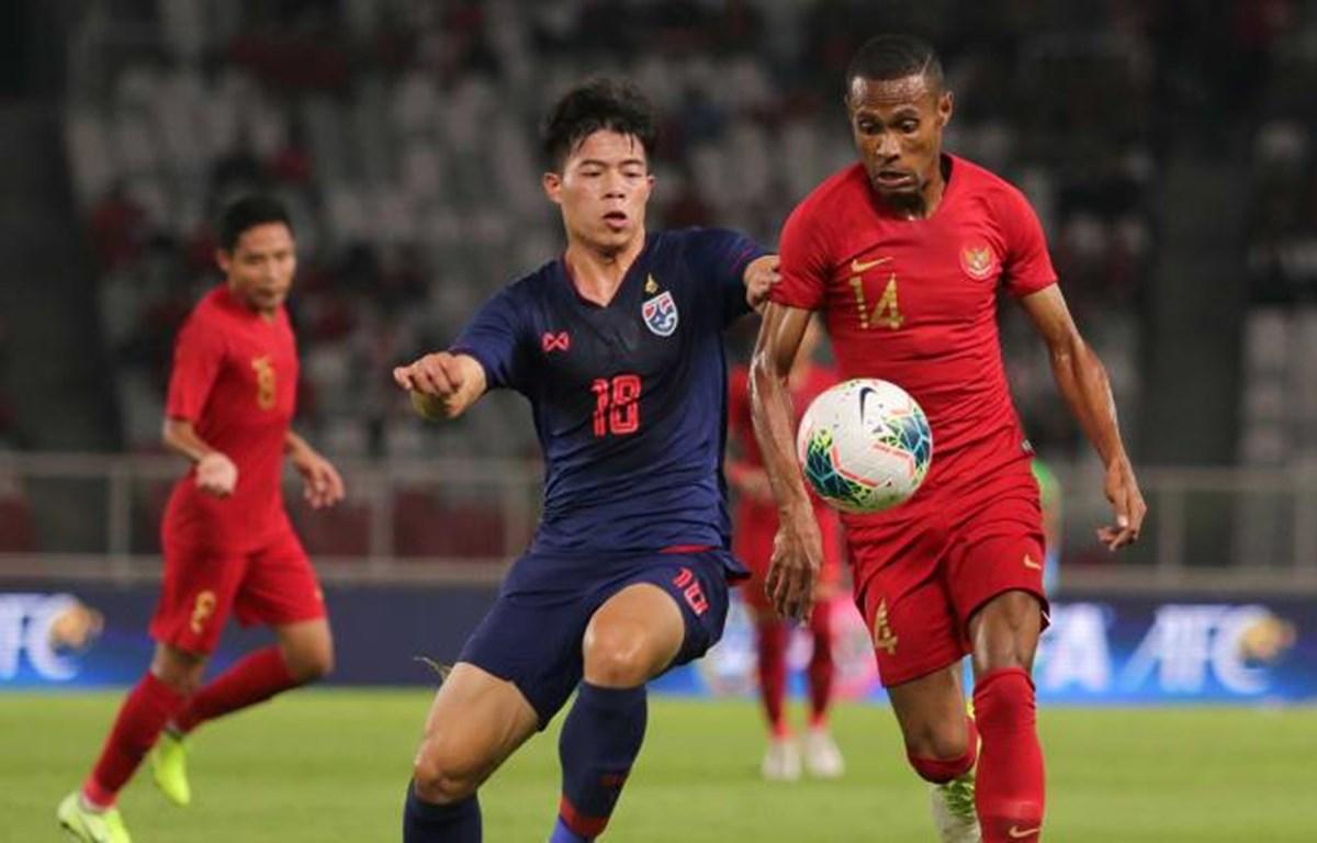 Indonesia (áo đỏ) bại trận trước Thái Lan. (Nguồn: AFC)