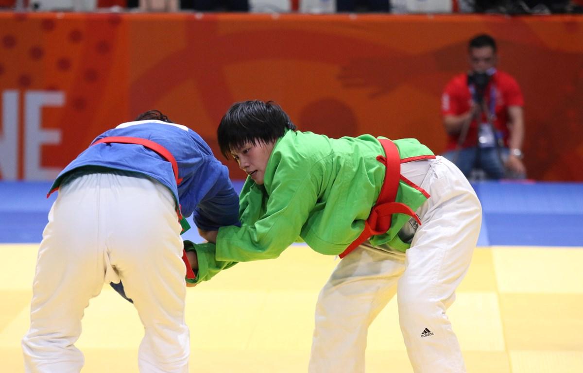 Nguyễn Thị Lan giành huy chương Vàng sau khi đánh bại đối thủ nước chủ nhà. (Ảnh: Vietnam+)
