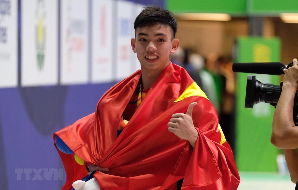Huy Hoàng đóng góp 2 HCV cho đoàn Thể thao Việt Nam. (Ảnh: Vũ Anh Tú/TTXVN)