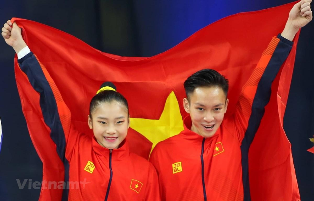 Phan Thế Gia Hiển-Bùi Minh Phương giúp Aerobic lập hat-trick huy chương Vàng. (Ảnh: Vietnam+)