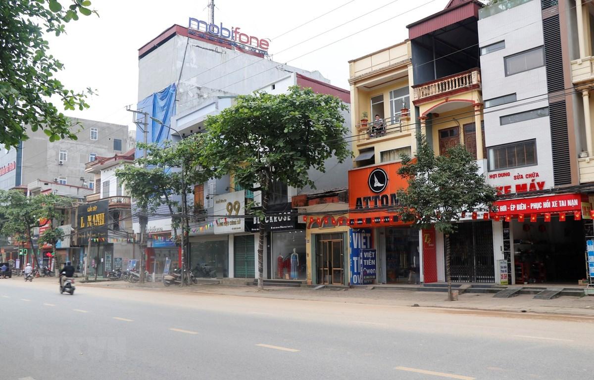 Cửa hàng bán hàng hóa không thuộc các mặt hàng thiết yếu đã đóng cửa trở lại theo chỉ đạo của thành phố Yên Bái. (Ảnh: Tuấn Anh/TTXVN)