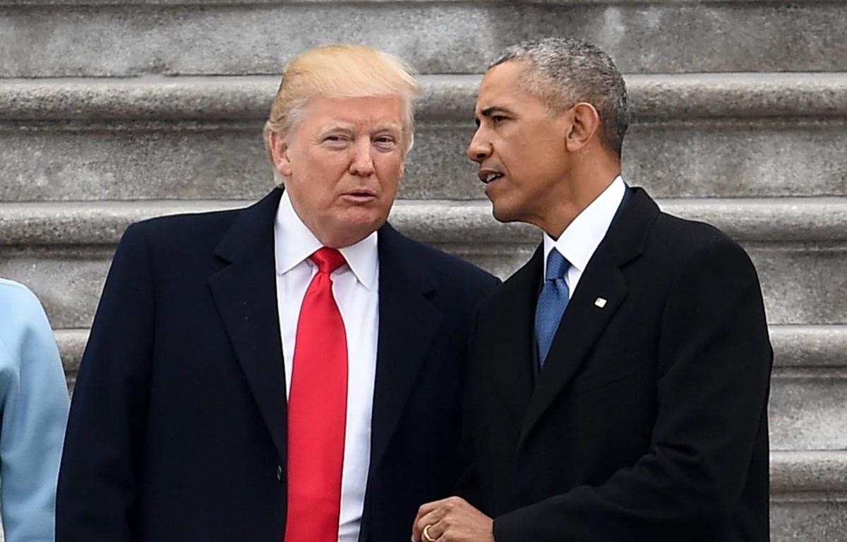 Tổng thống Mỹ Donald Trump và cựu Tổng thống Barack Obama. (Nguồn: AFP)