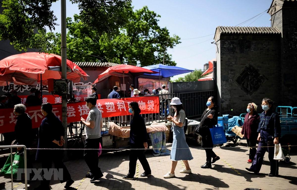 Trung Quốc thực hiện hạn chế đi lại tại các ổ dịch ở thành phố Cát Lâm. (Ảnh: AFP/TTXVN)