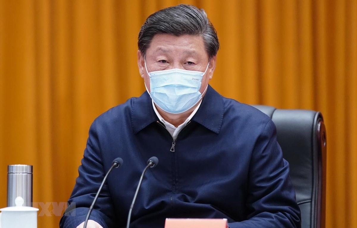 Chủ tịch Trung Quốc Tập Cận Bình trong chuyến thăm Vũ Hán, tỉnh Hồ Bắc, ngày 10/3. (Ảnh: THX/TTXVN)