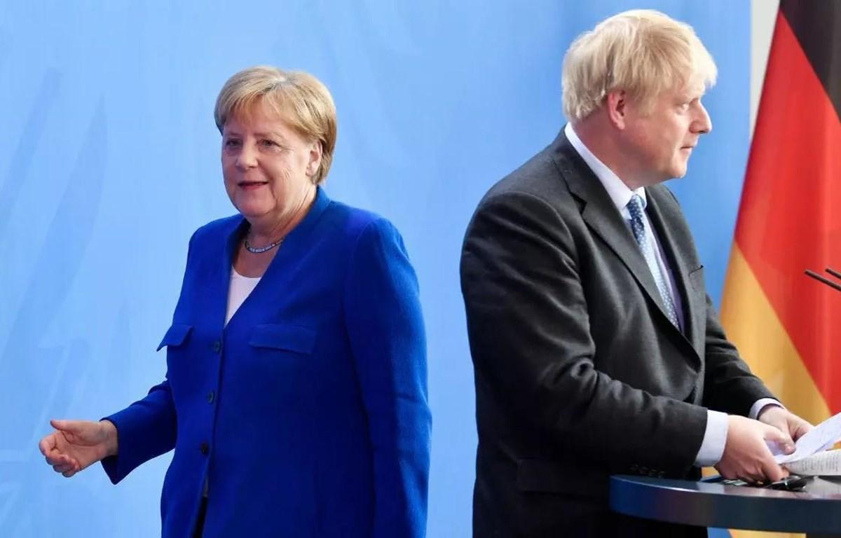 Thủ tướng Đức Angela Merkel và Thủ tướng Anh Boris Johnson rời cuộc họp báo tại Berlin ngày 21/8/2019. (Nguồn: AFP)