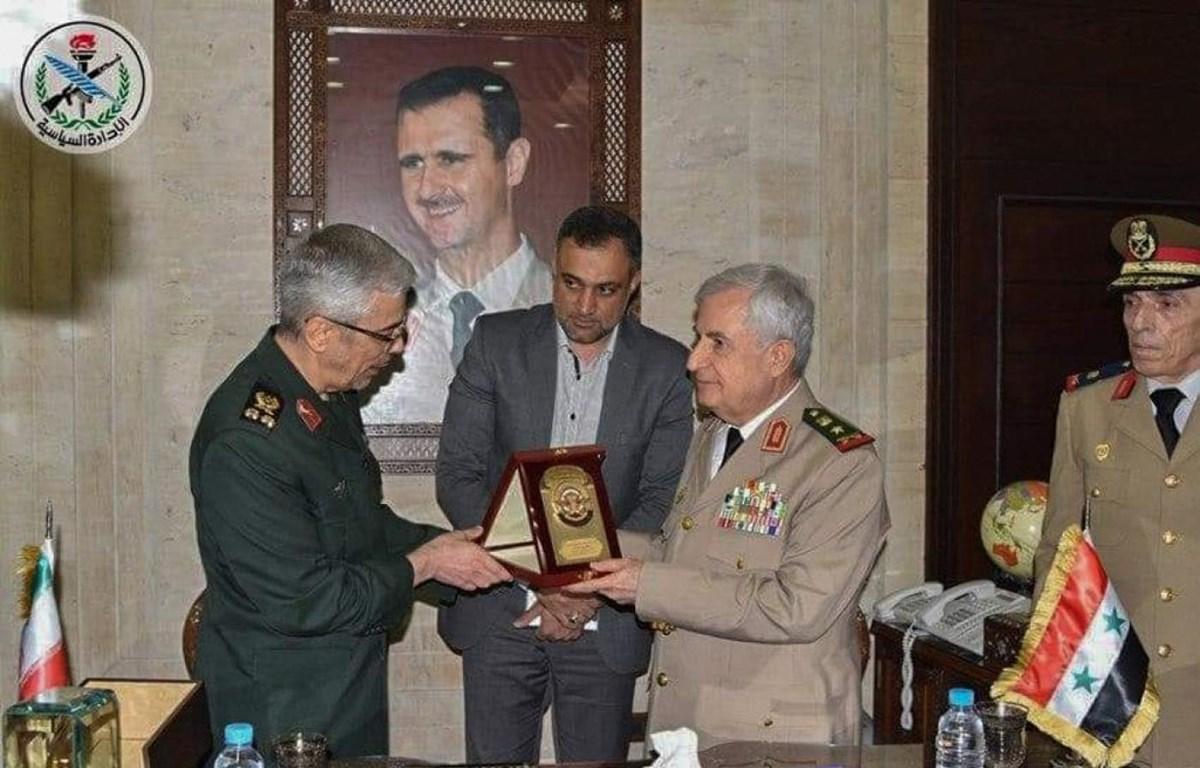 Lễ ký kết thỏa thuận mở rộng hợp tác quân sự giữa Iran và Syria. (Nguồn: AFP)