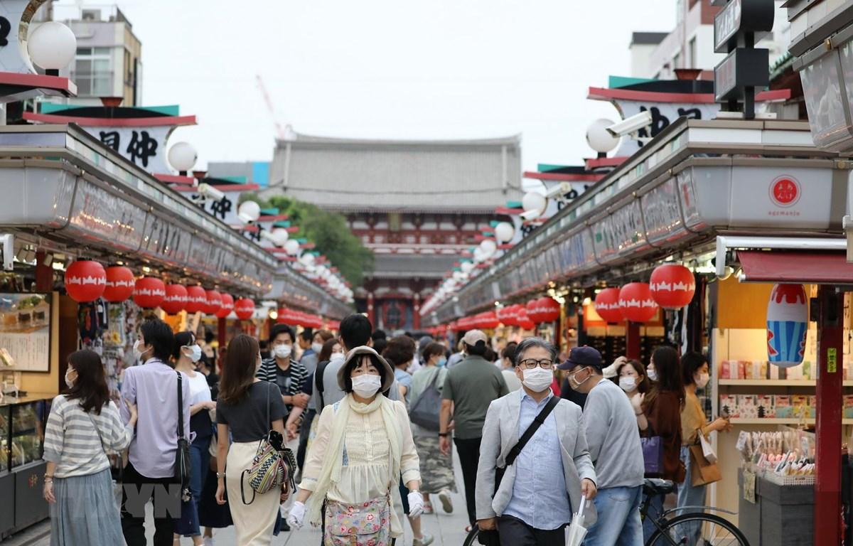 Tốc độ phục hồi kinh tế Nhật Bản có khả năng sẽ chậm lại do ảnh hưởng của dịch COVID-19 kéo dài. (Ảnh: THX/TTXVN)