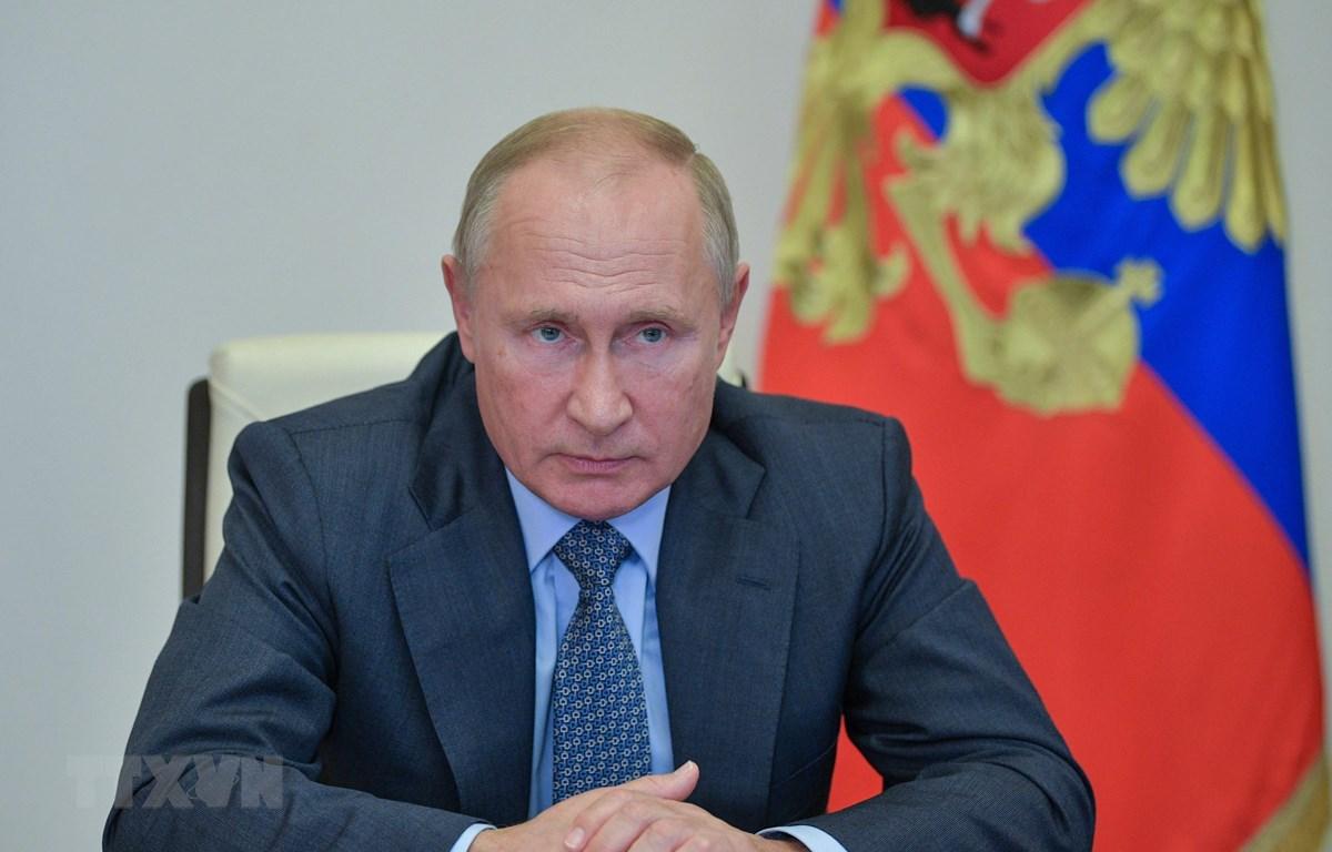 Tổng thống Nga Vladimir Putin tại cuộc họp trực tuyến ở Moskva, Nga. (Ảnh: AFP/TTXVN)