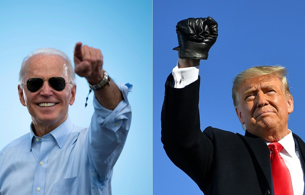 Cuộc đua vào Nhà Trắng giữa đương kim Tổng thống Donald Trump (phải) và ứng cử viên đảng Dân chủ Joe Biden được dự đoán sẽ rất căng thẳng. (Ảnh: AFP/TTXVN)