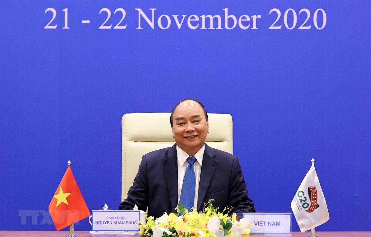 Thủ tướng Nguyễn Xuân Phúc phát biểu tại Hội nghị thượng đỉnh G20 trực tuyến. (Ảnh: Thống Nhất/TTXVN)