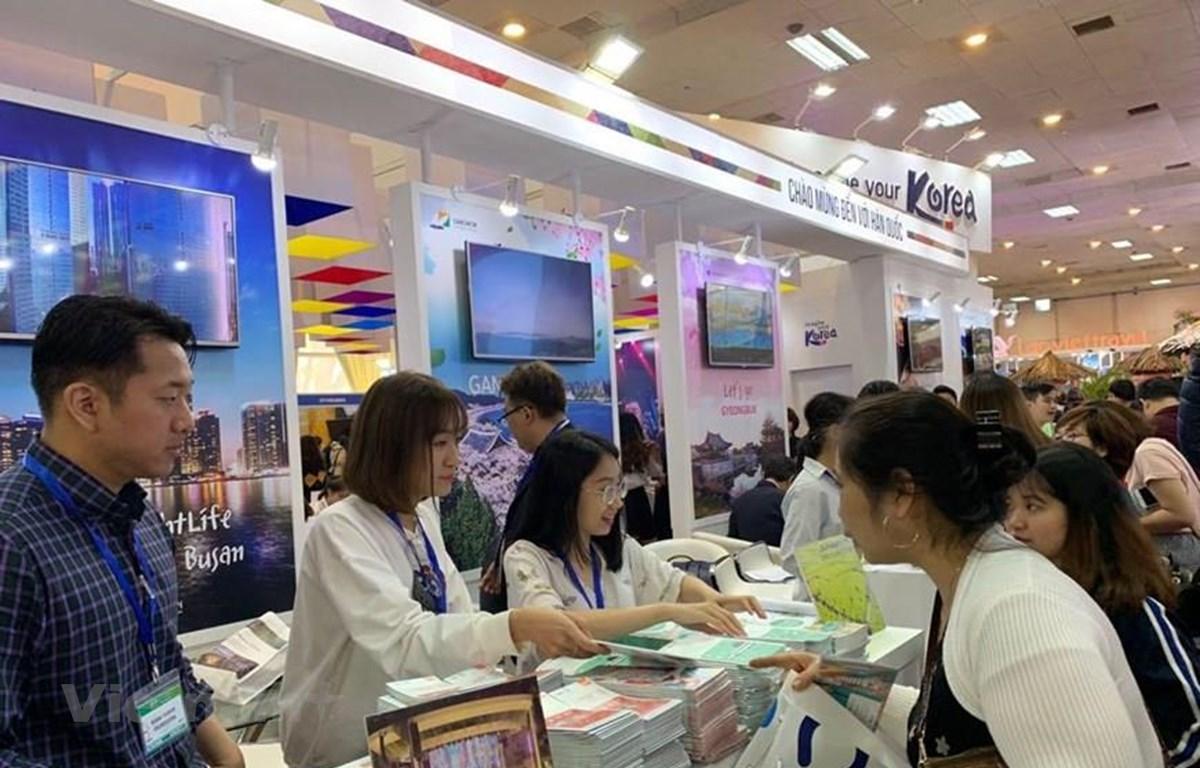 Khách đến Hội chợ du lịch quốc tế Việt Nam 2019. (Ảnh minh họa: Mai Mai/Vietnam+)