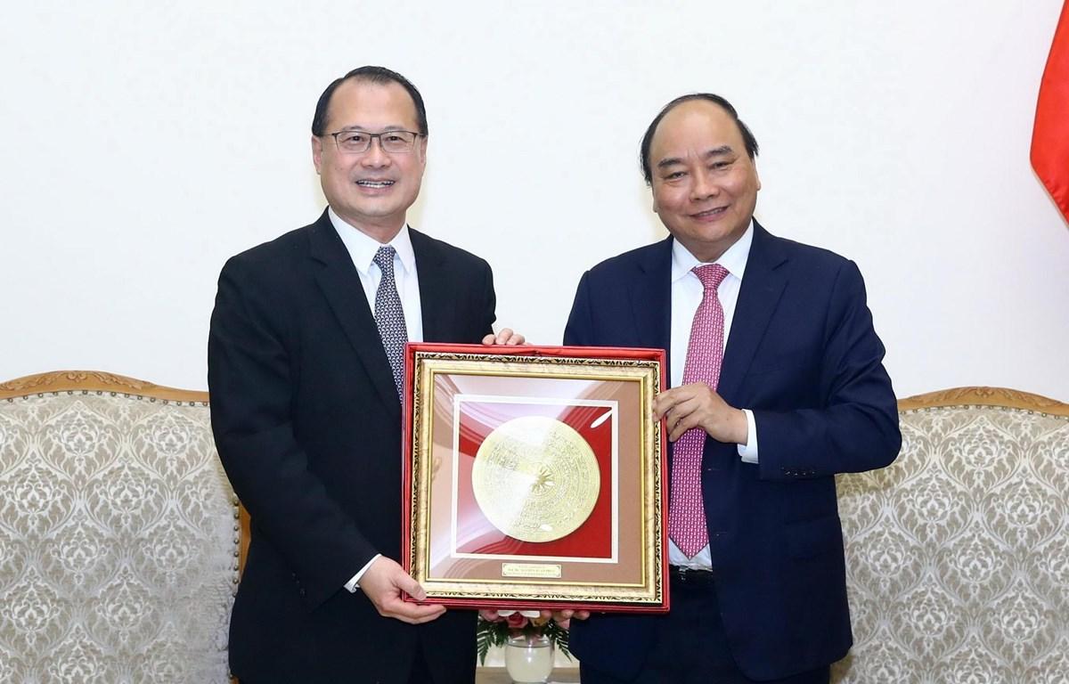 Thủ tướng Nguyễn Xuân Phúc tiếp ông Jonathan Choi, Chủ tịch Phòng Thương mại Hong Kong-Việt Nam. (Ảnh: Thống Nhất/TTXVN)