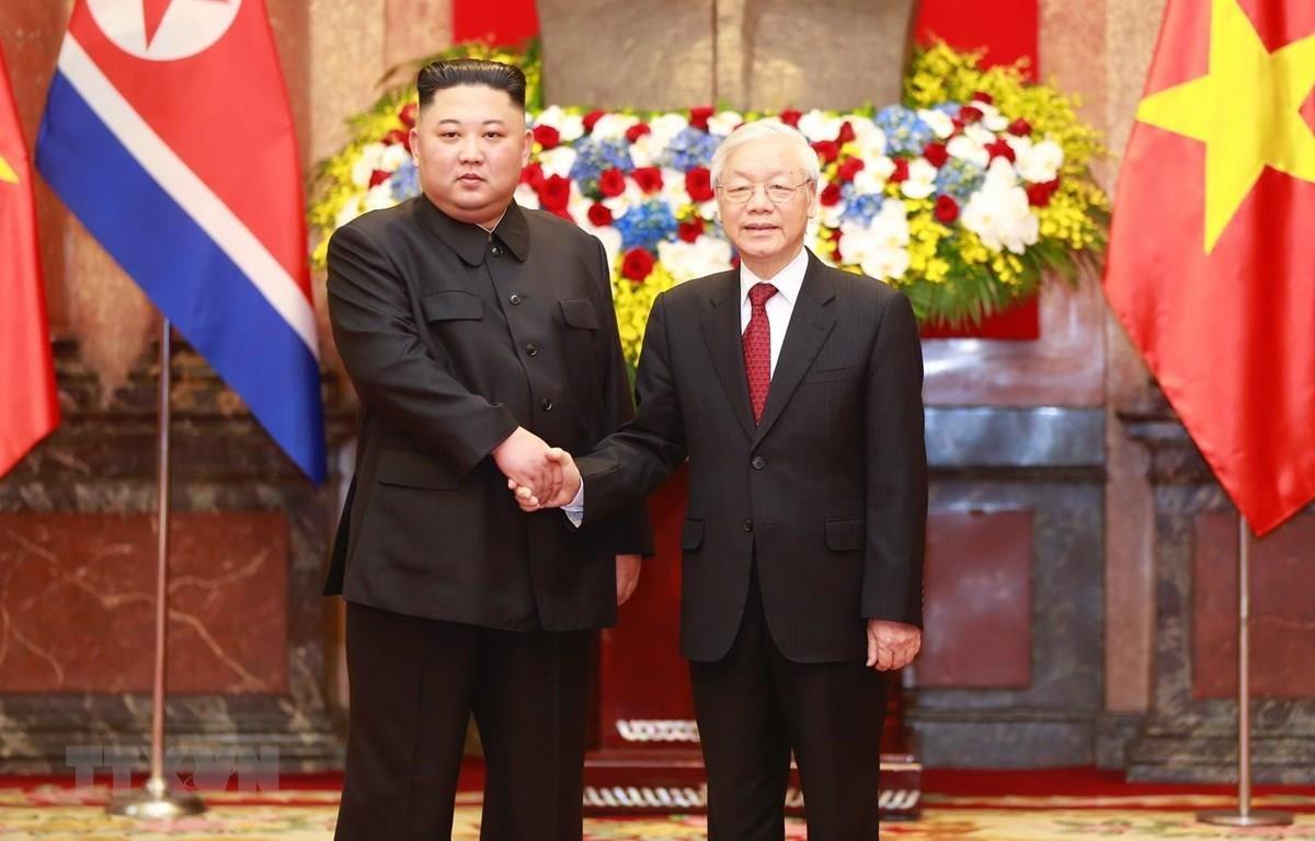 Tổng Bí thư, Chủ tịch nước Nguyễn Phú Trọng đón Chủ tịch Triều Tiên Kim Jong-un khi Chủ tịch Triều Tiên có chuyến thăm hữu nghị chính thức Việt Nam tháng 3/2019. (Ảnh: Doãn Tấn/TTXVN)