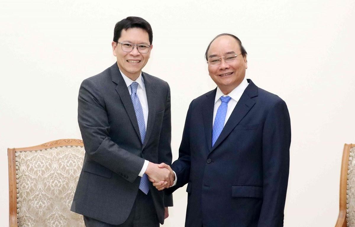 Thủ tướng Nguyễn Xuân Phúc tiếp Thống đốc Ngân hàng Trung ương Thái Lan Veerathai Santiprabhob đang thăm và làm việc tại Việt Nam. (Ảnh: Văn Điệp/TTXVN)