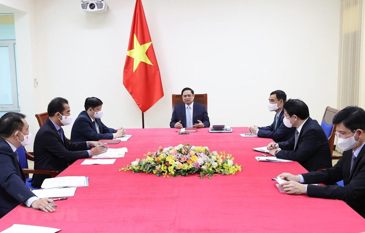 Thủ tướng Phạm Minh Chính điện đàm với Thủ tướng Pháp Jean Castex. (Ảnh: Dương Giang/TTXVN)