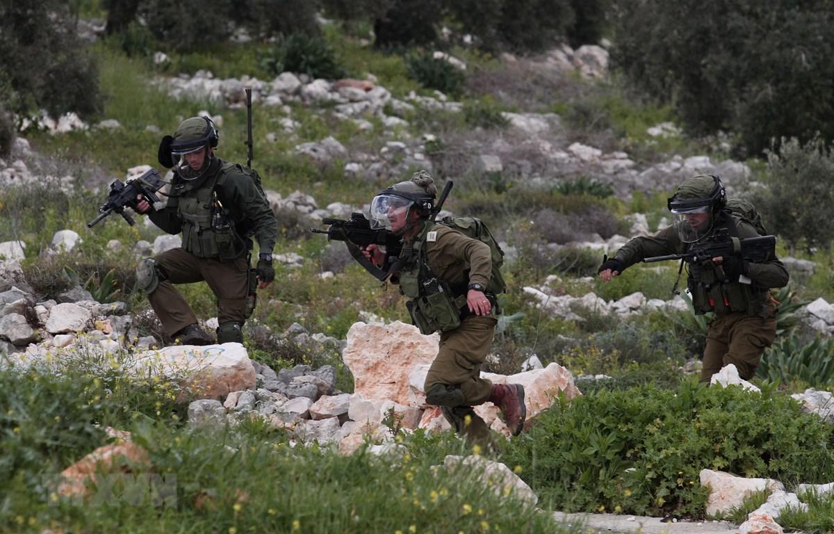 Binh sỹ Israel trong cuộc đụng độ với người biểu tình Palestine tại làng Kufr Qadoom, gần thành phố Nablus, Bờ Tây, ngày 15/3/2019. (Ảnh: THX/TTXVN)