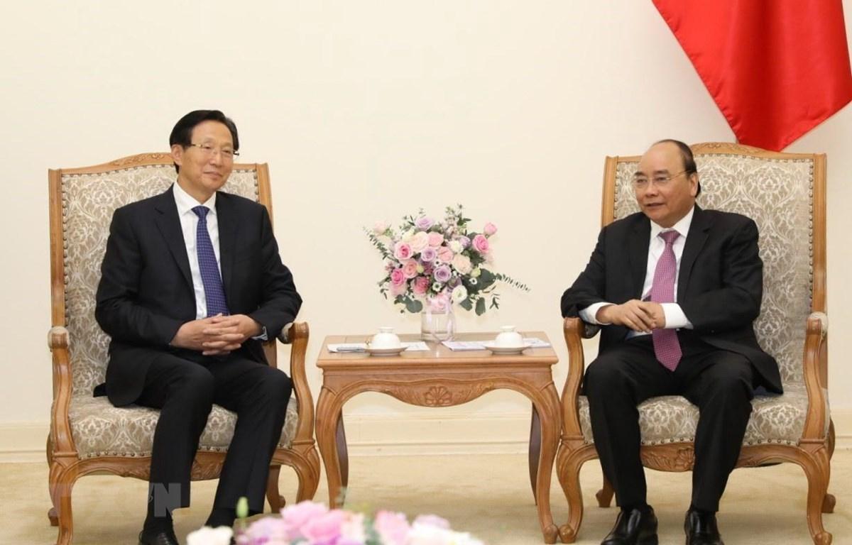 Thủ tướng Nguyễn Xuân Phúc tiếp Bộ trưởng Bộ Nông nghiệp nông thôn Trung Quốc Hàn Trường Phú. (Ảnh: Văn Điệp/TTXVN)