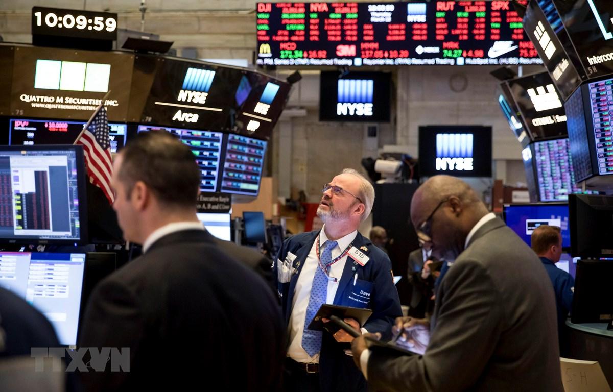 Trong ảnh: Giao dịch viên tại thị trường chứng khoán New York, Mỹ ngày 12/3/2020. (Ảnh: THX/TTXVN)