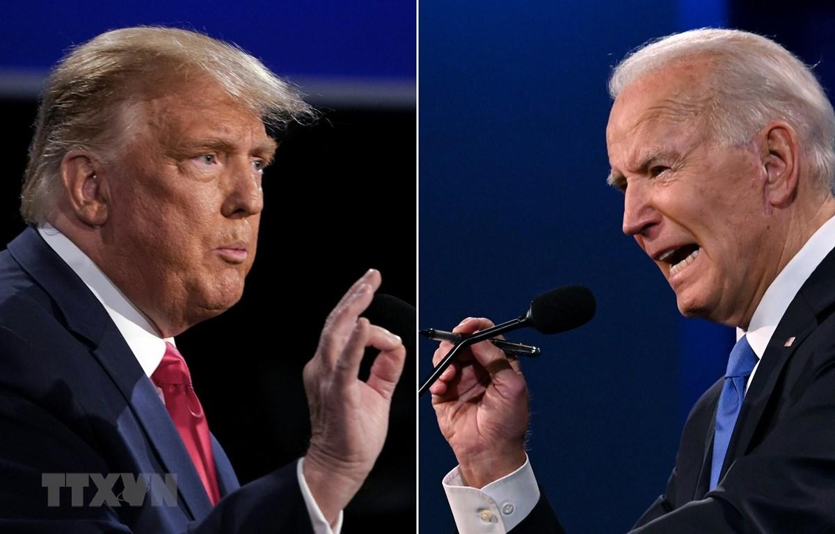 Tổng thống Mỹ Donald Trump (trái) và ứng viên Tổng thống của đảng Dân chủ Joe Biden tại vòng tranh luận trực tiếp cuối cùng ở thành phố Nashville, bang Tennesse. (Ảnh: AFP/TTXVN)