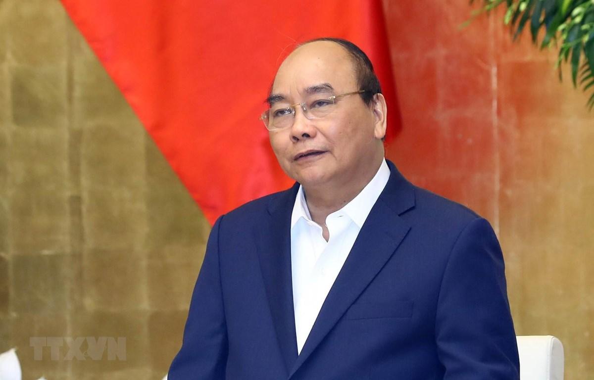 Thủ tướng Nguyễn Xuân Phúc phát biểu khai mạc phiên họp Chính phủ thường kỳ tháng 2. (Ảnh: Thống Nhất/TTXVN)