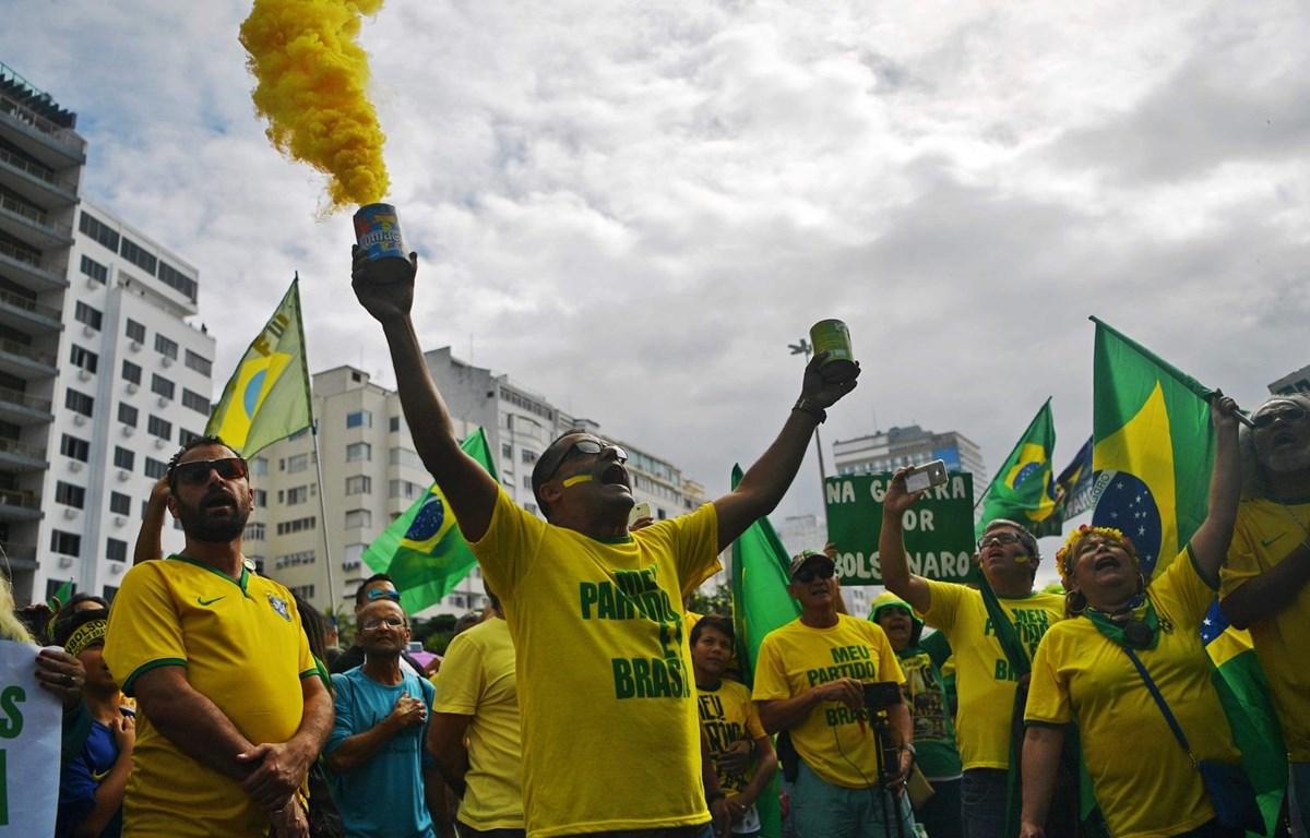 Người biểu tình ở Brazil, ngày 26/5. (Nguồn: AFP)