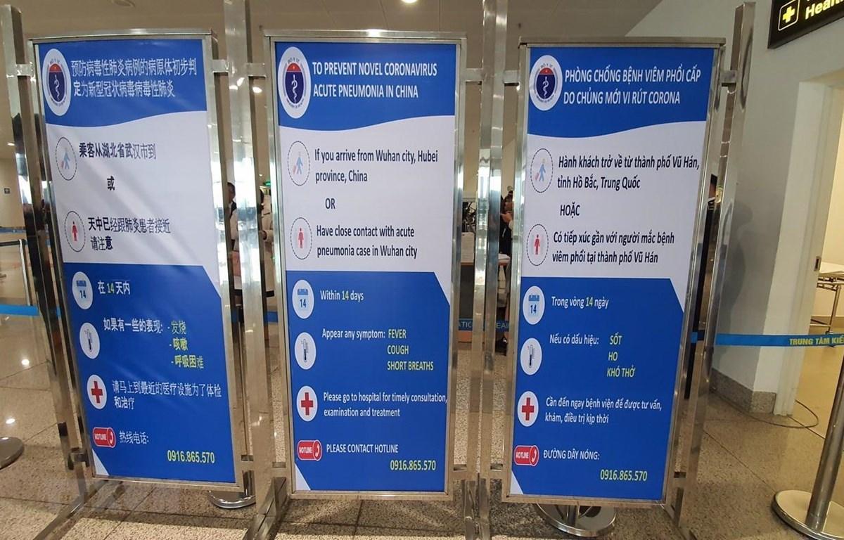 Bộ Y tế cảnh báo phòng chống nhiễm viêm phổi cấp do chủng virus mới nCoV tại hệ thống kiểm dịch y tế quốc tế sân bay quốc tế Nội Bài. (Nguồn: TTXVN phát)