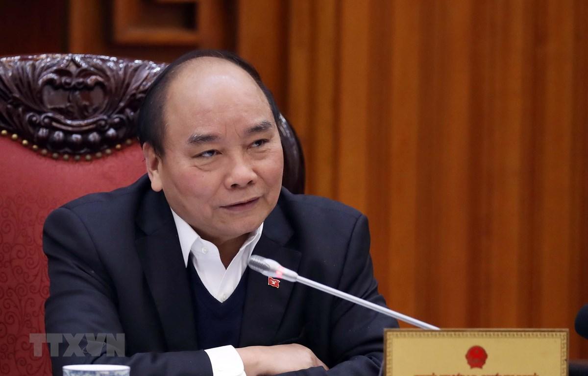 Thủ tướng Nguyễn Xuân Phúc chủ trì họp Thường trực Chính phủ tìm các giải pháp nhằm tháo gỡ khó khăn cho ngành mía đường. (Ảnh: Thống Nhất/TTXVN)