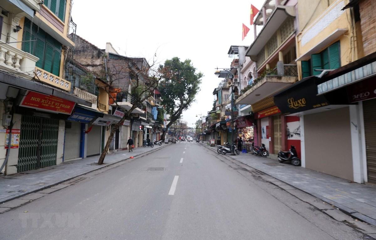 Đường phố Hà Nội vắng vẻ trong những ngày dịch COVID-19. (Ảnh: Anh Tuấn/TTXVN)