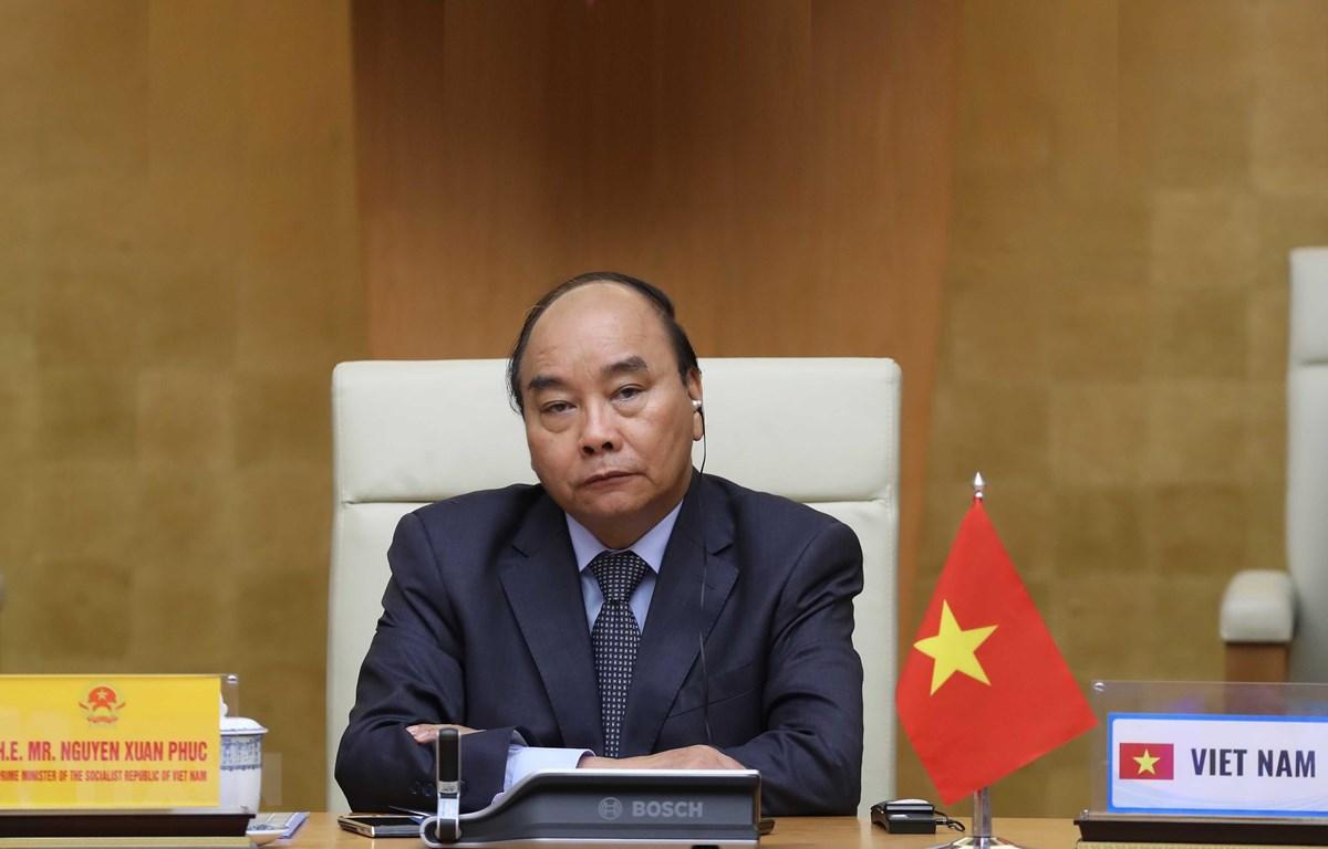 Thủ tướng Nguyễn Xuân Phúc tham dự Hội nghị thượng đỉnh trực tuyến G20 về ứng phó dịch COVID-19. (Ảnh: Thống Nhất/TTXVN)