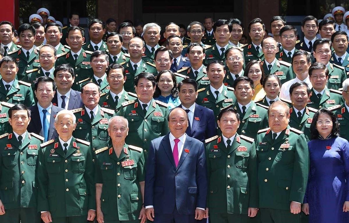 Thủ tướng Nguyễn Xuân Phúc, Phó Chủ tịch Đặng Thị Ngọc Thịnh với các đại biểu. (Ảnh: Thống Nhất/TTXVN)