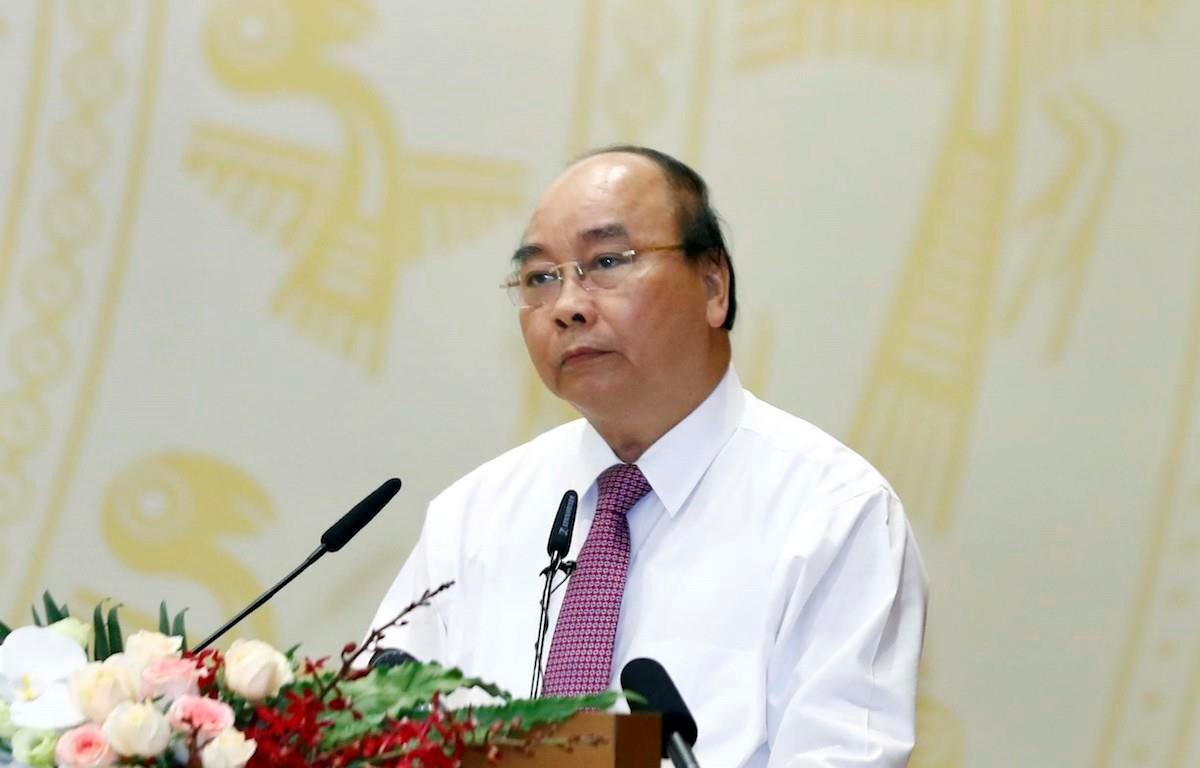 Thủ tướng Chính phủ Nguyễn Xuân Phúc chủ trì Hội nghị trực tuyến Chính phủ với các địa phương ngày 4/7. (Ảnh: TTXVN)