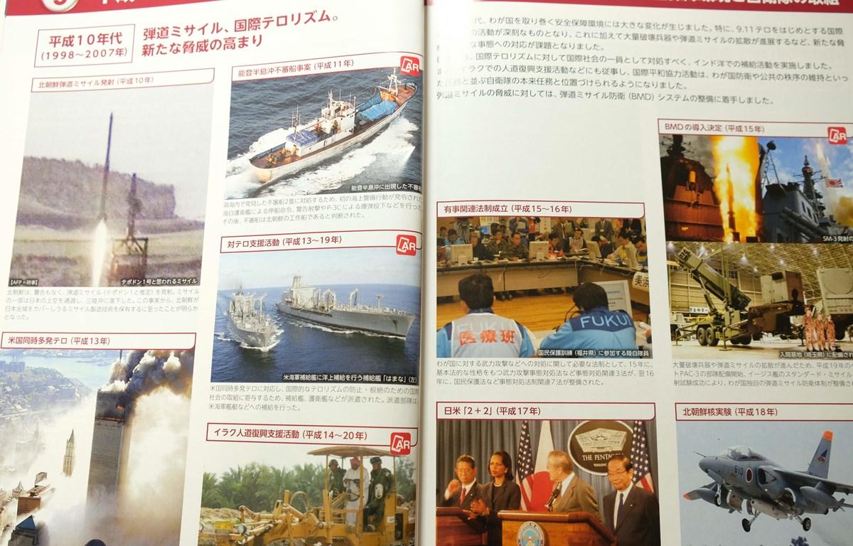 Trong ảnh: Nội dung trong sách trắng Quốc phòng của Nhật Bản. (Ảnh: Bùi Hồng Hà/TTXVN)