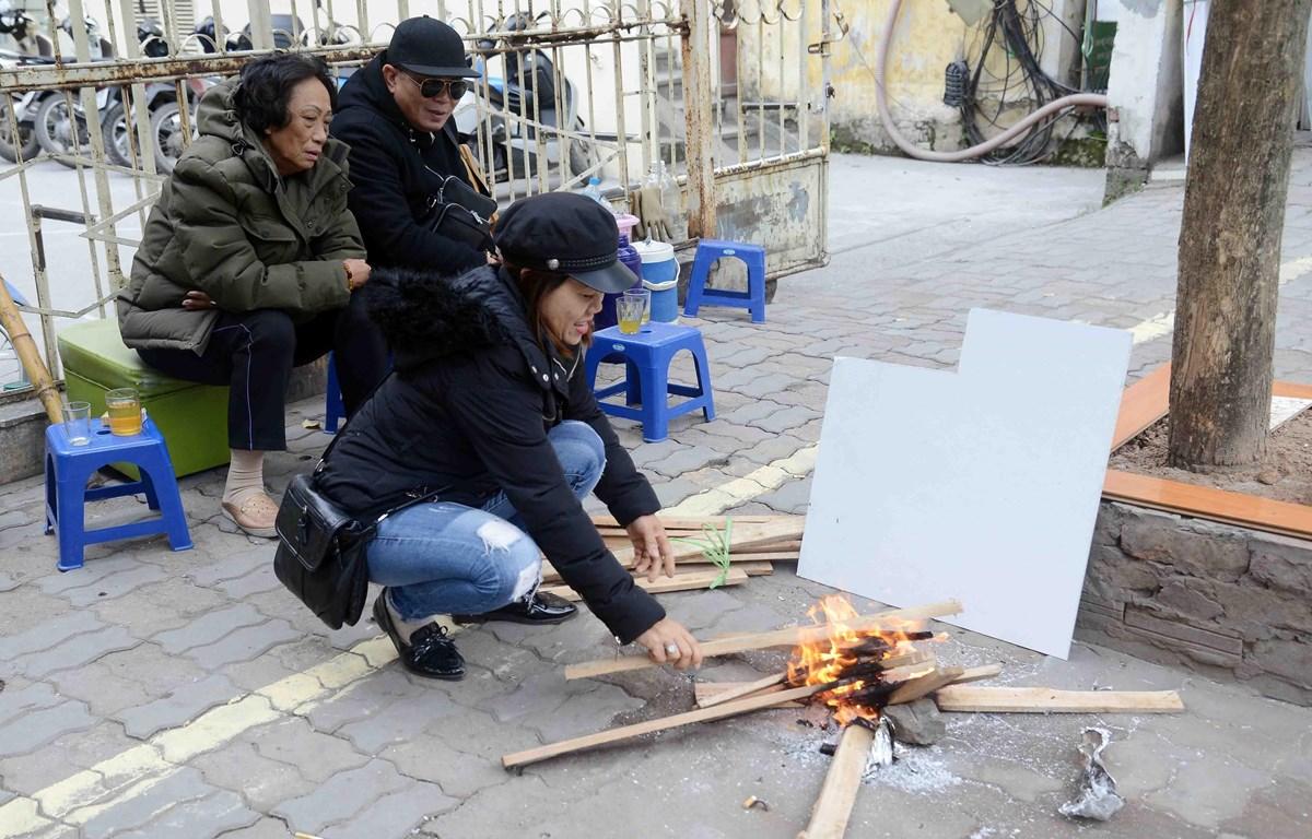 Người dân tại Hà Nội. (Ảnh: Quang QuyếtTTXVN)