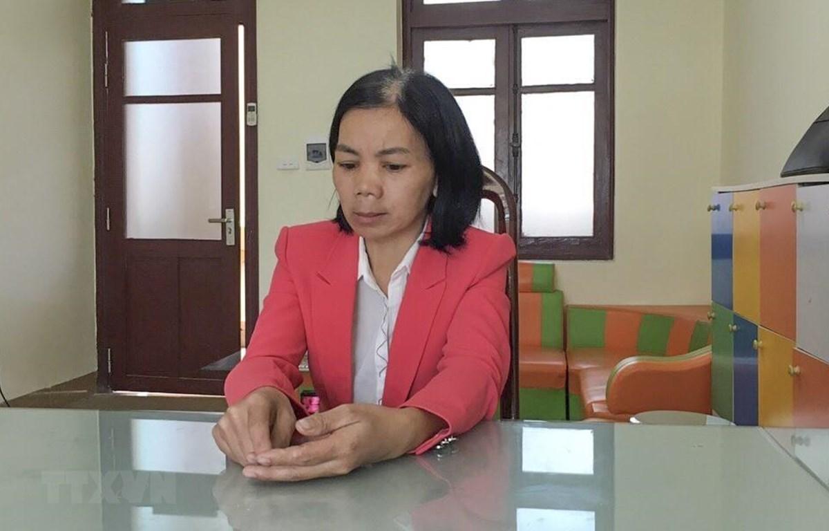 Đối tượng Bùi Kim Thu là vợ của đối tượng Bùi Văn Công bị bắt trước đó. (Ảnh: TTXVN phát)
