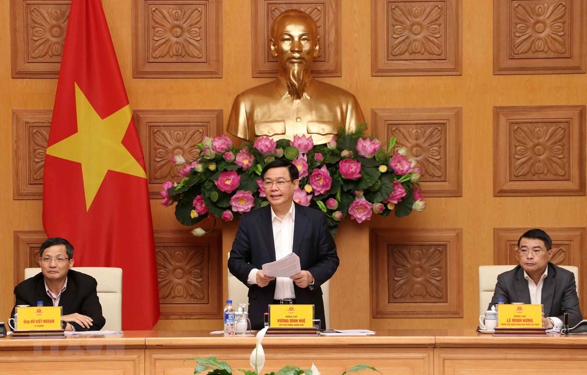 Phó Thủ tướng Vương Đình Huệ, Chủ tịch Hội đồng Tư vấn chính sách tài chính, tiền tệ quốc gia chủ trì cuộc họp. (Ảnh: Văn Điệp/TTXVN)