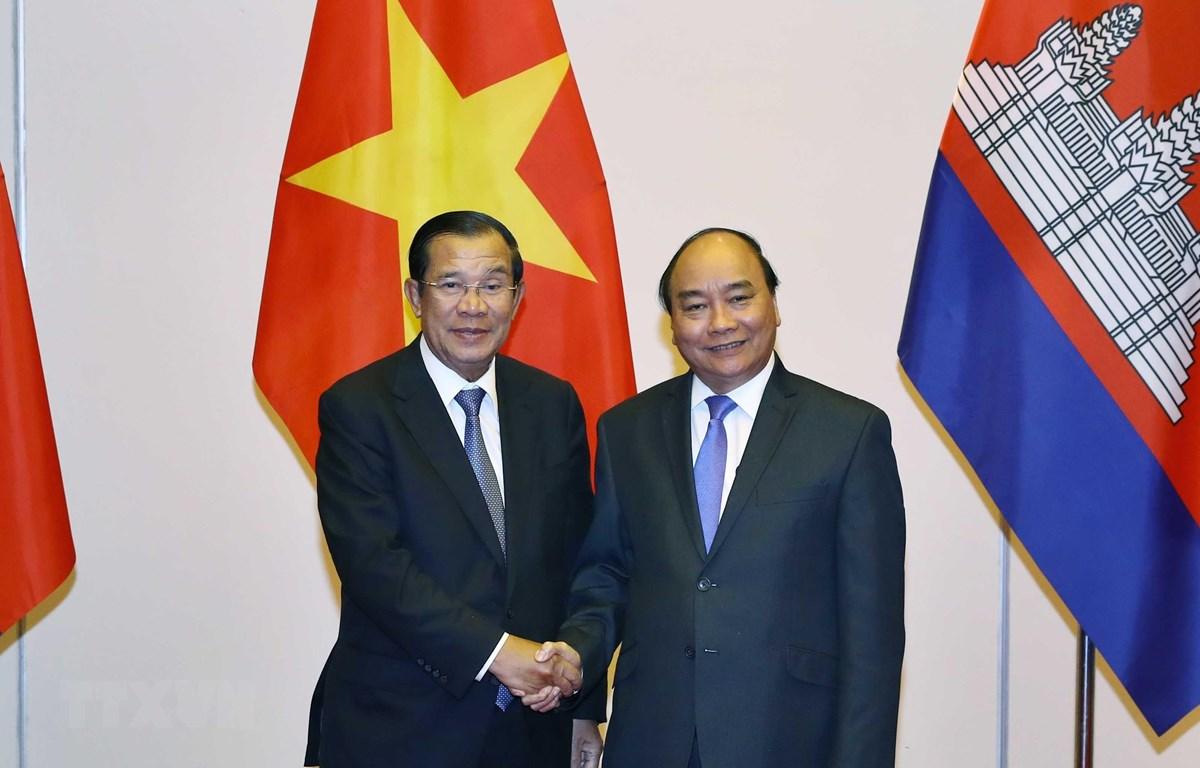 Thủ tướng Nguyễn Xuân Phúc tiếp Thủ tướng vương quốc Campuchia Samdech Techo Hun Sen sang dự Lễ Quốc tang nguyên Chủ tịch nước Lê Đức Anh. (Ảnh: Thống Nhất /TTXVN)