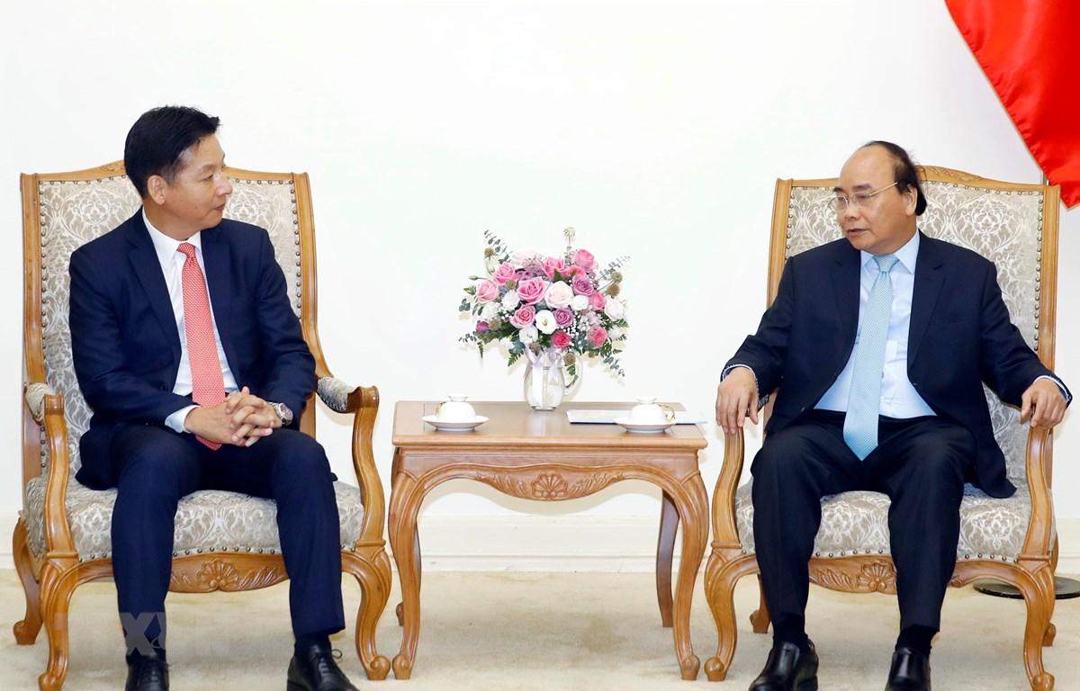 Thủ tướng Nguyễn Xuân Phúc tiếp ông Yasutsugu Iwamura, Giám đốc điều hành Tập đoàn AEON Nhật Bản, kiêm Tổng giám đốc AEON MALL Việt Nam. (Ảnh: Thống Nhất/TTXVN)
