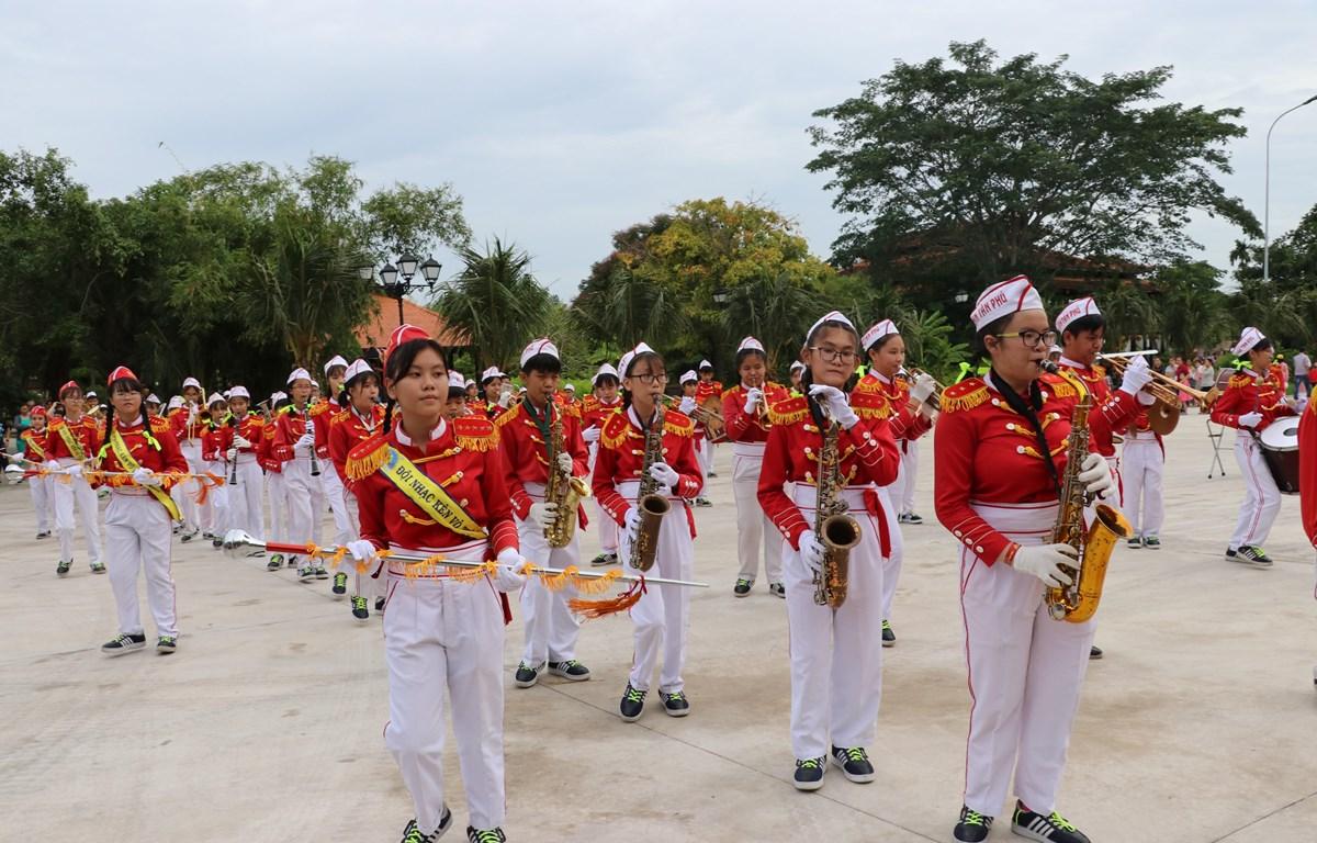 Đội nhạc kèn thiếu nhi có số lần công diễn nhiều nhất thế giới - Đội nhạc kèn Võ Thành Trang. (Ảnh: Đức Hạnh/TTXVN)